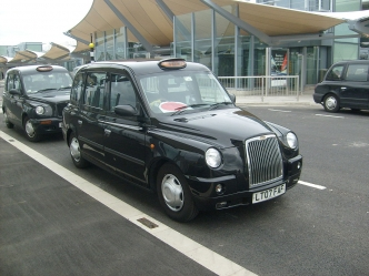 1280px-A_TX4_Taxi_at_Heathrow_Airport_Terminal_5.jpg