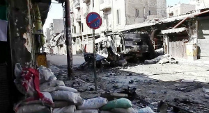 Bombed_out_vehicles_Aleppo.jpg