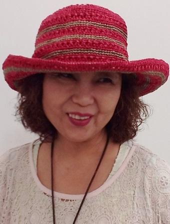 赤い帽子がおしゃれでしょ。