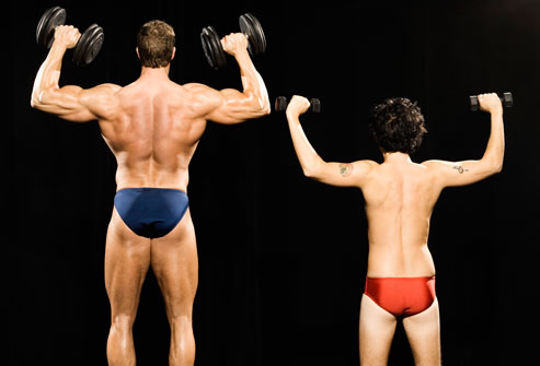 getty_rf_photo_of_two_guys_lifting_weights.jpg